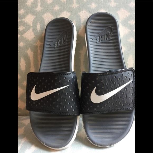79360cdf98869f Nike Men s Flex Motion Slide Sandal Black Size 13.  M 5b4f8e38477368fbe2ac1501